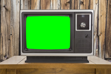 Old Television with Chroma Key Green Screen and Rustic Wood Wall