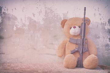 Teddy bear with toy gun