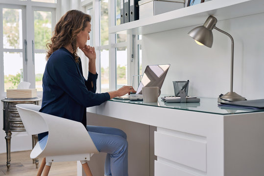 mature woman working from modern home