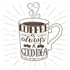 Hand drawn cup of coffee with text and decorative elements