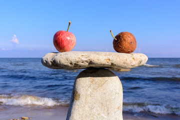 Fresh apples on stones
