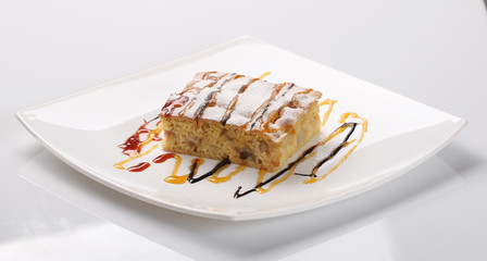piece of apple pie decorated with caramel