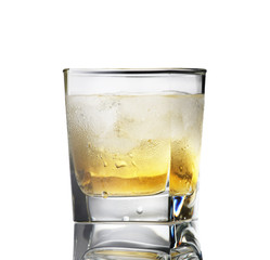 whiskey with ice in a sweaty glass on a white background i