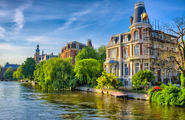 Amstel river with beautiful houses in Amsterdam, Holland, Nether