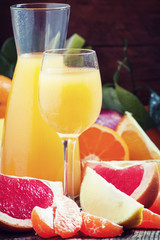 Freshly squeezed citrus juice with pulp and fruit pieces, select