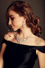 beautiful brunette woman with bijou, wears elegant black dress