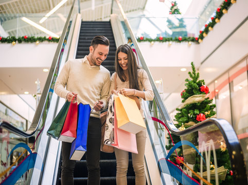 Loving couple doing Christmas shopping together