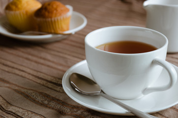 White Cup of Tea and Cup Cake for Tea Break.