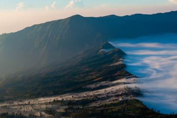 Haze Sliding through the Mountains into a city next to volcano Bromo
