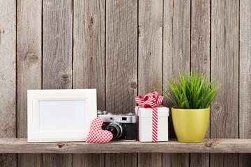 Blank photo frame, heart, camera and plant