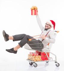 Happy man lying in shopping cart