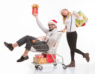Happy man and woman with shopping cart
