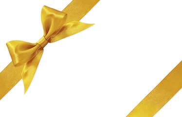 Shiny golden satin ribbon bow isolated on white background
