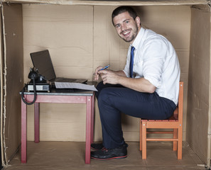 happy businessman in the small office