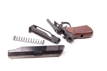Disassembled gun, isolated