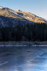 Wall Mural - Ice - reflections on frozen lake