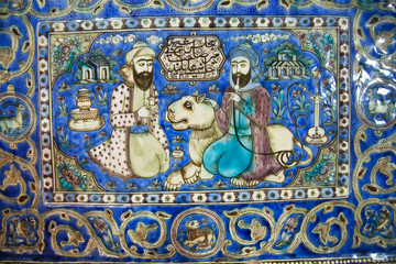 Ceramic tiles of 19th century with a lion and two persian men talking in garden