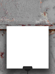 Single hanged square frame on rusty metal gate background