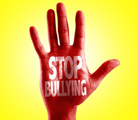 Stop Bullying written on hand with yellow background