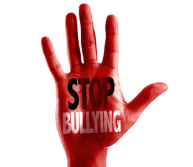 Stop Bullying written on hand isolated on white background