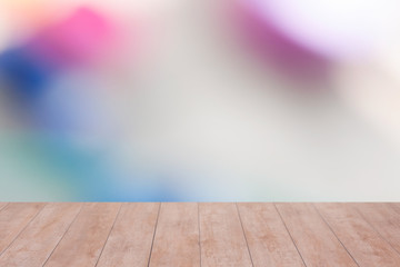 Wood table top on color abstract blurred background. ready for product display