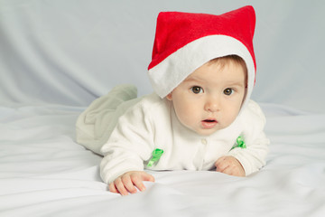 Cute happy newborn baby in christmas hat