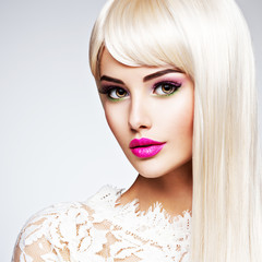 Portrait of beautiful blonde woman with pink lipstick
