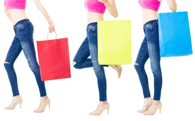 Legs of shoppers with shopping bags