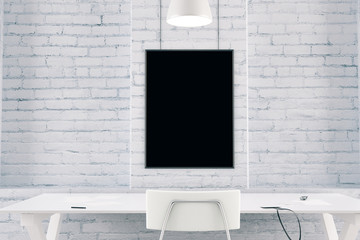 Blank black picture frame on a brick wall with table and chair,