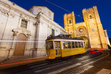 Tram in front of the Lisbon Cathedral at night