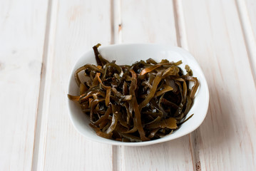 seaweed in a bowl on a wooden table