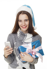 Young beautiful girl with mobile holding present