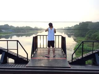 the man take photo of nature on the bridge
