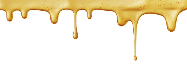 flow of sweet honey on the white background