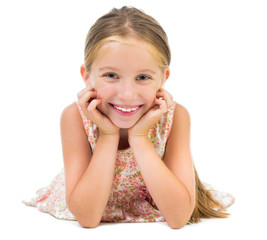 smiling little girl lying on the floor