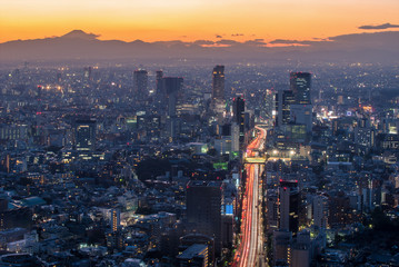 The sun sets over the cityscape of Tokyo