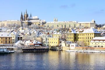Christmas snowy Prague gothic Castle above River Vltava in the sunny Day, Czech Republic