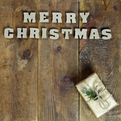 text Merry Christmas on old wooden background