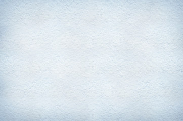 Flat white or light blue snow background texture. Space for lettering, text or copy.