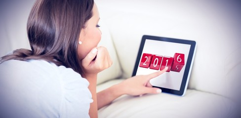 Composite image of woman touching her digital tablet