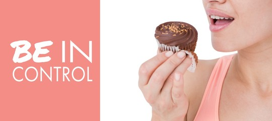 Composite image of smiling brunette holding chocolate cupcake