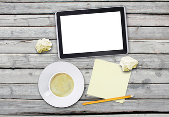 Tablet with blank screen and cup of coffee