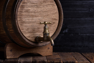 Vintage wooden barrel on rack