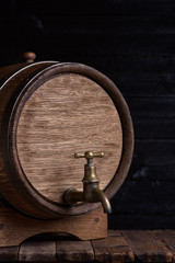 Vintage oak barrel on wooden table still life