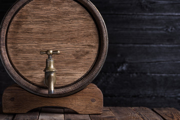 Old oak barrel on wooden table still life with copy space