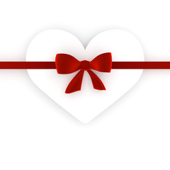 the red bow and the white heart on the white heart