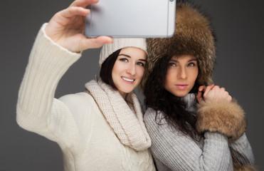 Two girls taking selfie.