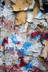 Graffitti on flaking and damaged paint