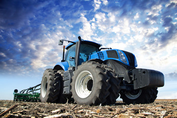 Blue tractor working on the farm