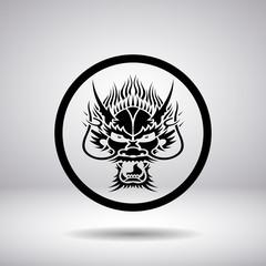 Dragon head silhouette in a circle